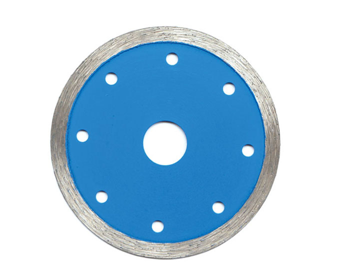 Sintered continuous rim diamond saw blades for granite marble